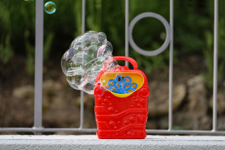 Soap bubble in the air from bubble machine. Banque d'images - 123867494