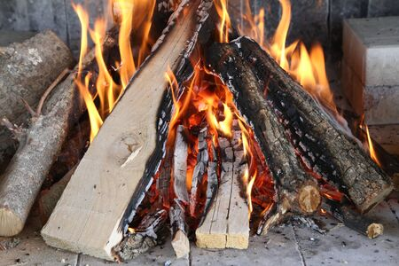 Fire, flame and burning wood for the grill Stock Photo