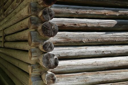 Log cabin home. Wall of house from logs.