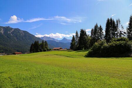 Mountain huts on green meadows in the Alps. Stok Fotoğraf