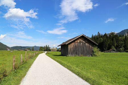 Mountain huts on green meadows in the Alps. 版權商用圖片