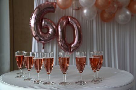 Filled with champagne glasses for the 60th anniversary.