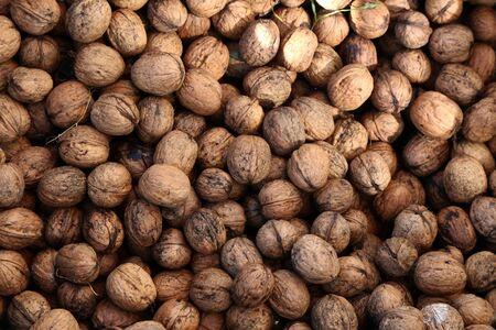 Natural walnut background pattern texture. Abstract walnuts heap pattern background. Natural food in-shell nuts walnuts pattern backdrop Reklamní fotografie