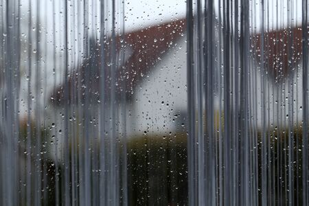 Background. It s raining outside the window - There are drops of water on the windows
