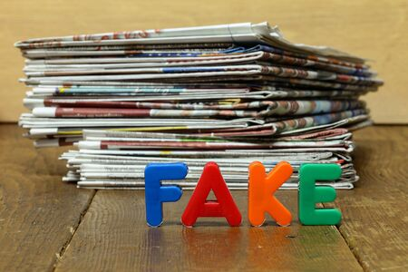 Fake news concept with newspapers and letters 版權商用圖片 - 133053053