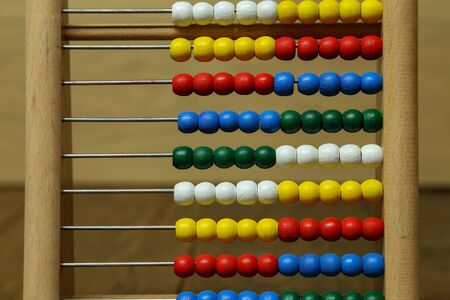 Children's colorful abacus for counting with multi-colored wooden beads. Stockfoto