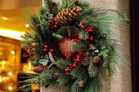 Christmas decoration of spruce twigs, cones and red berries.