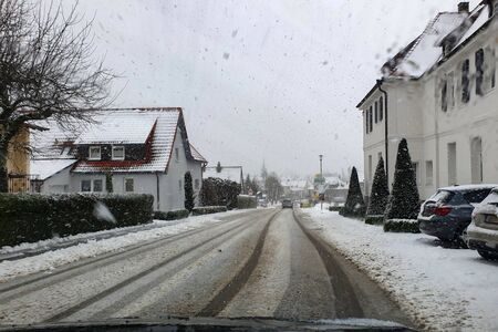 Street of a small town in snowfall