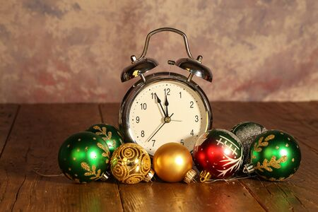 New Years still life with an alarm clock and bright balls.