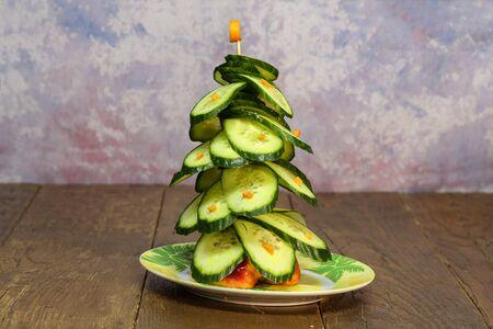 Green christmas tree of cucumbers to the festive table. Фото со стока