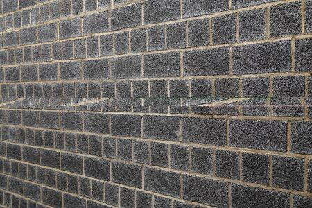 Garage wall lined with black foam block