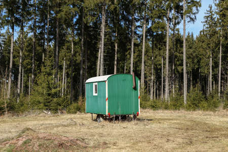 Mobile logger hut stands in the forest