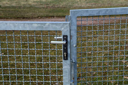 Metal mesh gate with internal lock and handle