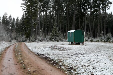Mobile logger hut stands in the forest.