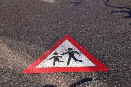 Children on the road, sign painted on the asphalt 版權商用圖片