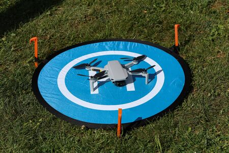 Drone stands on a take-off and landing pad
