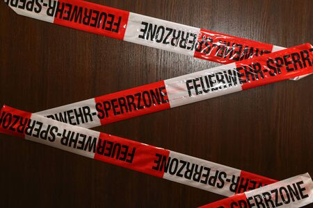 Stickers on a door. Text in German: Fire department - restricted area