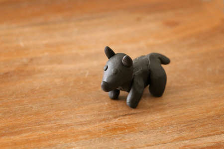 Animals fashioned by children from plasticine - a dog.