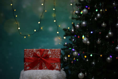 Christmas gift on the background with a decorated Christmas tree Reklamní fotografie