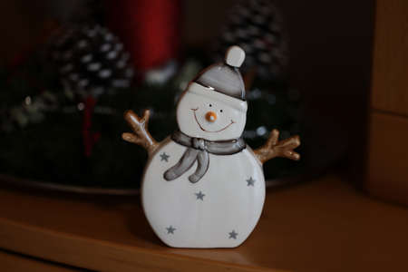 Merry snowman christmas holiday decoration stands on the table