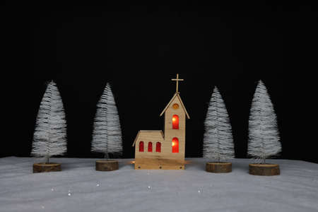 Landscape with a small church made of plywood on Christmas night
