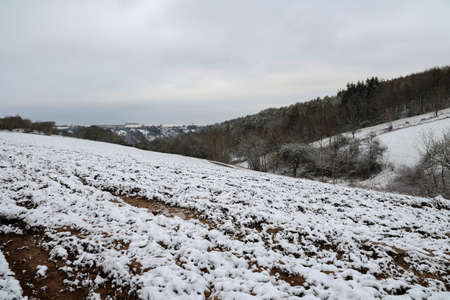 Fields and arable land are covered with white snow in winter