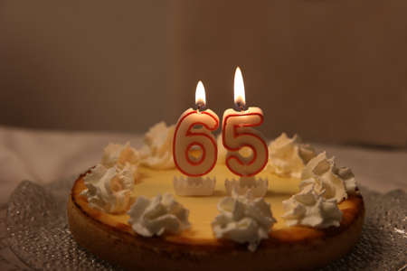 An image of a birthday cake with candle - 65 Reklamní fotografie