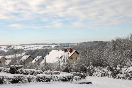 Winter. The roofs of the houses are covered with snow. Reklamní fotografie