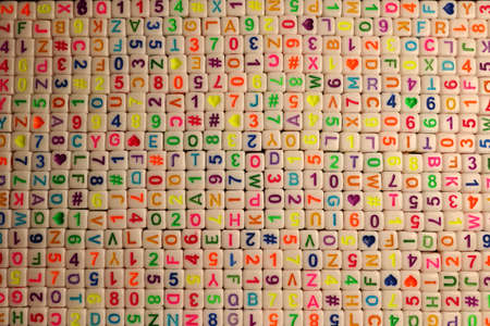 Background from cubes with letters and numbers