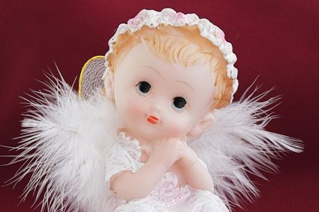 guise: White angel in the guise of child against the dark background