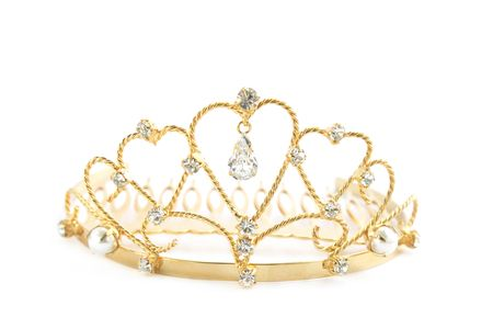 Gold diadem with the precious stones and the pearls photo