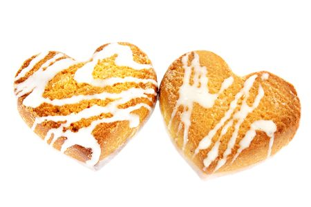 The cookies in the form of heart against the white background photo