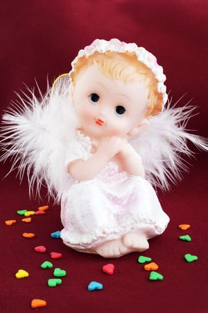 White angel in the guise of child against the dark background photo
