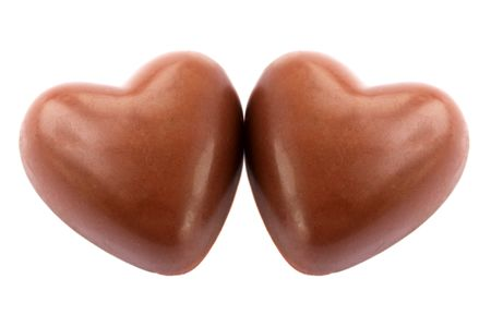 Two chocolate hearts against the white background photo