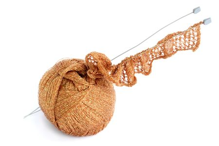 Ball of threads and knitting needle against the white background Stock Photo - 6322752