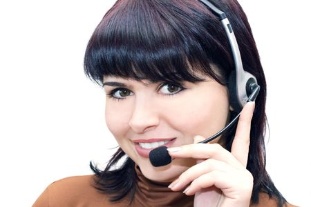 A friendly secretary/telephone operator in an office environment. Stock Photo - 6506255