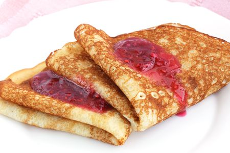 Pancakes with raspberry jam the breakfast of the house Stock Photo