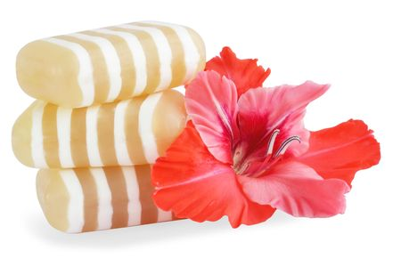 glycerin soap: Glycerin soap with the flower of the gladiolus Stock Photo