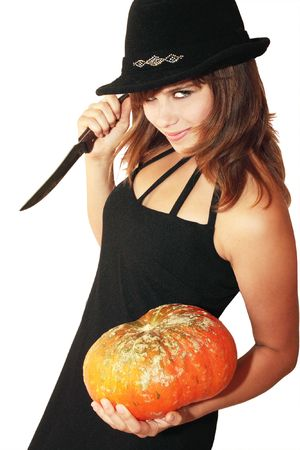 Witch holds in the hands pumpkin and knife photo