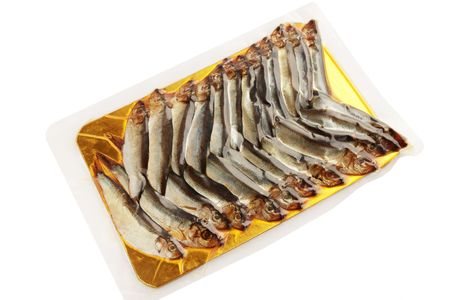 Smoked fish is sprat in the vacuum packing