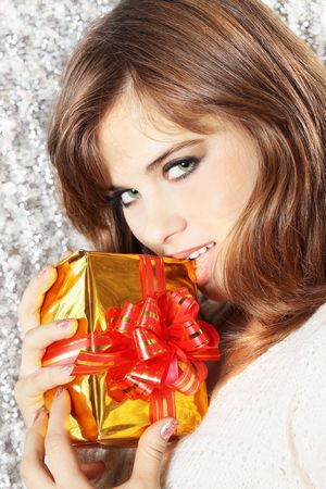 Sexual young woman with the gift in the hands