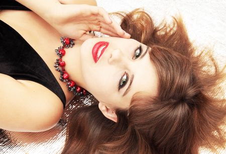 Beautiful young woman in the coral beads Stock Photo - 8141166
