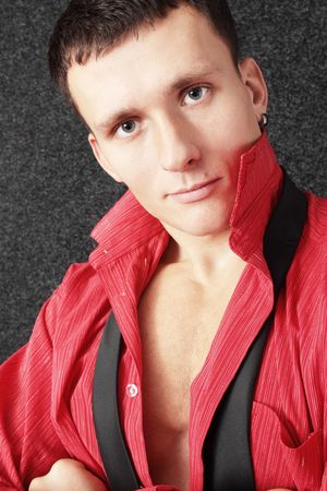 Beautiful young man in the unbuttoned red shirt Stock Photo - 8141192