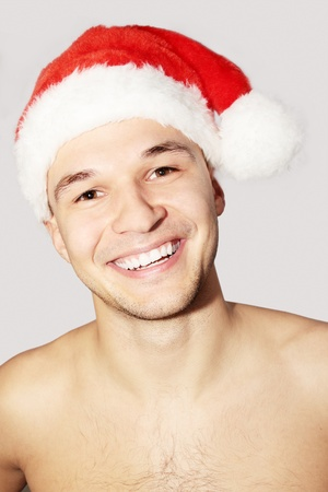 Young man in the cap Santa Claus Stock Photo - 8301761