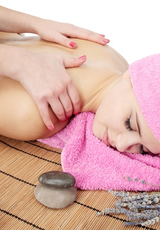 Beautiful young woman delights in by the massage Stock Photo - 8353116