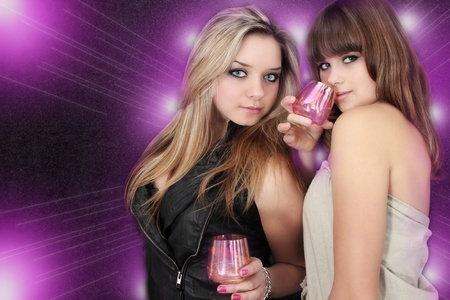 Two beautiful young women on the party photo