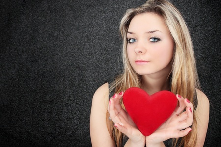 Beautiful blond holds in the hands the heart Stock Photo - 8433440