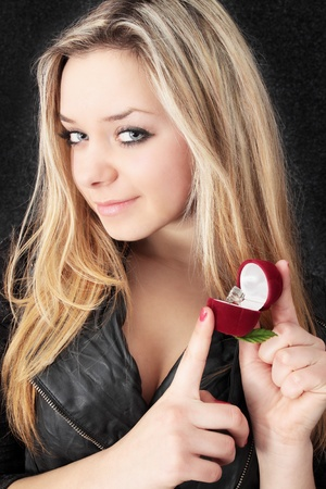 Beautiful blond holds in the hands box the ring Stock Photo - 8772549