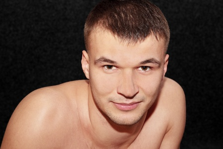 Portrait of the undressed man on the black Stock Photo - 8874712