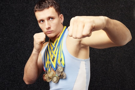 There are many medals on the neck the athlete has
